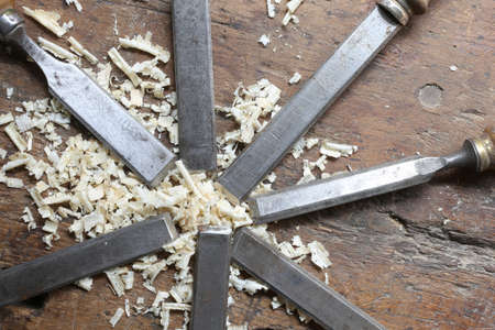 chisels: sharp steel blades many chisels and sawdust chippings in Workbench