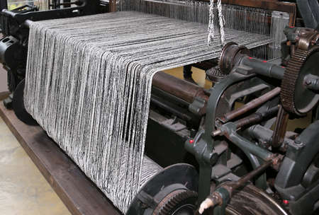 industria textil: old last century loom in the textile industry  for the production of woolen blankets