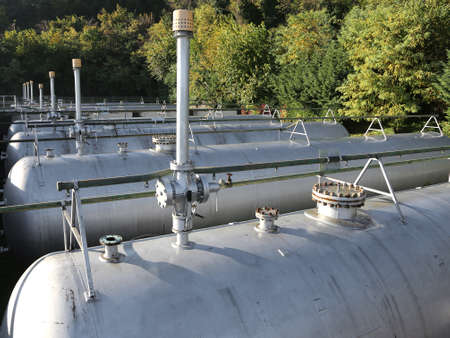 production area: many long giant gas pressure vessels for the storage of flammable gas in the restricted area of the fuel production refinery
