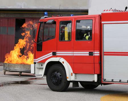fire brigade: fire trucks in fire brigade station during a fire drill Stock Photo