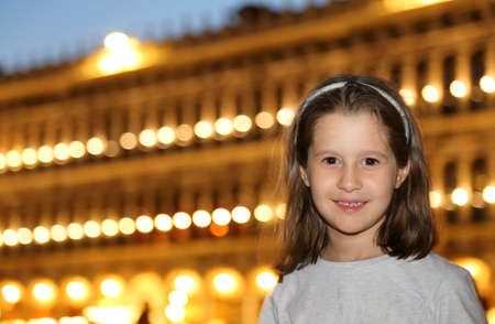 procuratie: young smiling little girl with the background of a Venetian Palace of Procuratie