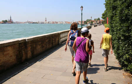 hayride: family of tourists walking on the island of Venice in Italy Stock Photo