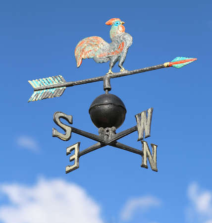roster: ancient weathervane with cock above an arrow and the four cardinal points North East West South