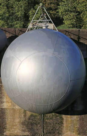 propane gas: long giant gas tank for the storage of flammable propane gas in the fuel production refinery