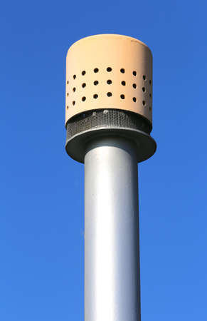 vent: yellow vent pipe above the large pressure vessel for the storage of natural gas
