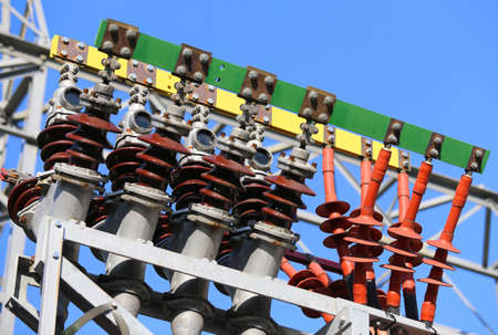 powerhouse: Insulators of a power plant with large electric power transmission lines connected to the voltage transformer connector Stock Photo