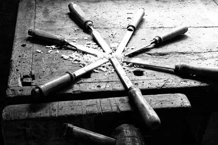 chisels: series of many sharp steel blades many chisels and sawdust chippings in an old Workbench