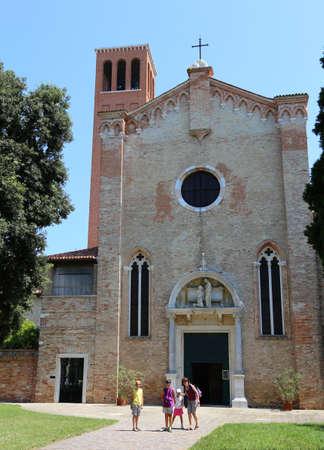 hayride: family of tourists in Venice in Italy near the Church of Santa elena Stock Photo