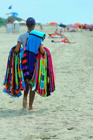 pedlar of cloth and towels on the beach