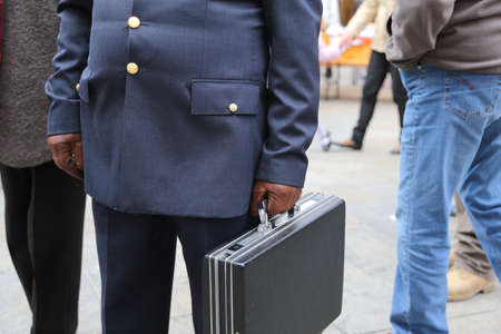 bribes: corrupt cop with a suitcase with many secret documents