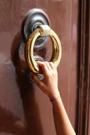 hand of young girl knocks on the closed door with the big brass handle photo & Child Hand Knocking At The Closed Door Stock Photo Picture And ...