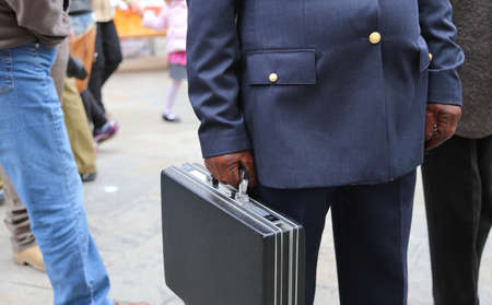 corrupt cop with a suitcase full of money after payment