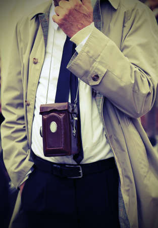 journalistic: old photojournalist with antique camera and vintage clothes Stock Photo