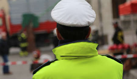 watchman: chief of police with uniform phosphorescent and white hat during the traffic control Stock Photo