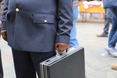 bribes: cop with a suitcase with many secret documents