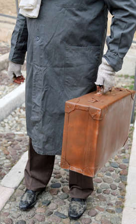 immigrated with old leather suitcase on the trip of hope