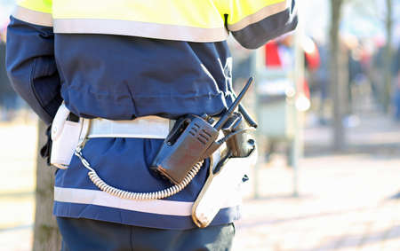 technical department: policeman with a radio transmitter and gun during a demonstration of the protesters Stock Photo
