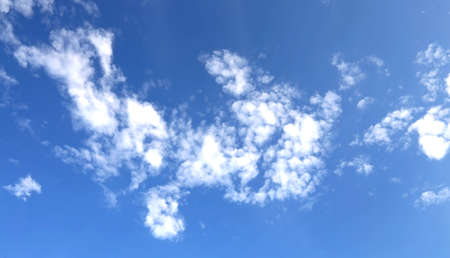 respiration: small white clouds in the blue clear sky in summer