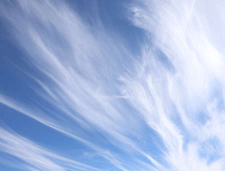 cirrostratus: high strange white clouds in the blue sky after the storms