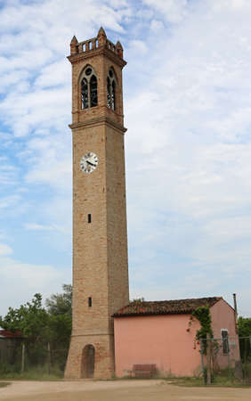 belltower: church tower with clock in the site called Lio Piccolo near Venice in Italy