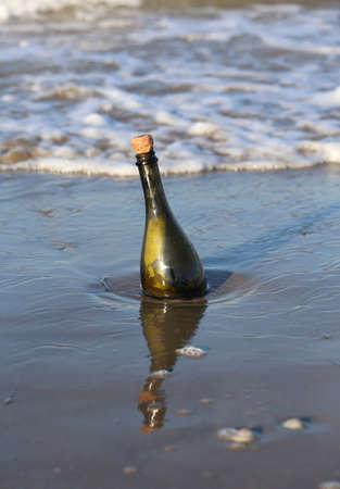 Secret Message in the bottle on the beach of ocean
