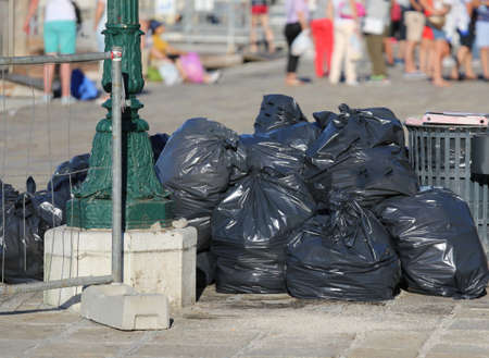 refusal: many black bags of garbage in the European tourist city
