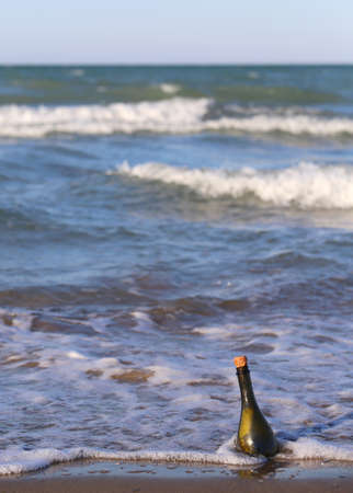 co cork: Message in the bottle on the beach of ocean