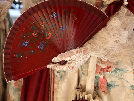 18th century: elegant woman with an ancient ceremonial dress and the fan in her hand with glove Stock Photo
