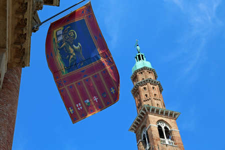 Vicenza, Italy, old citys most famous monument Tower called Basilica Palladiana with venetian flag Stock Photo