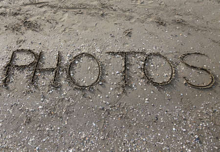 written: PHOTOS written on the beach sand