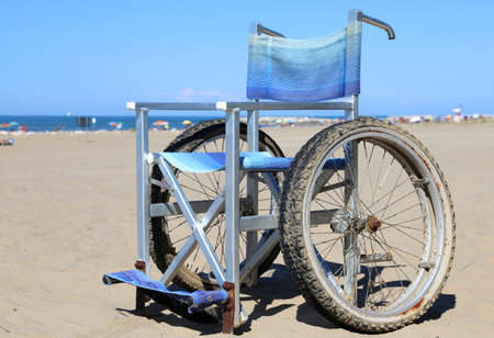 aluminum wheels: Modern aluminum  wheelchairs with special wheels with double tire moving on beach