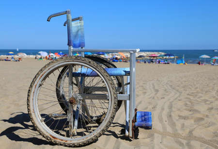 aluminum wheels: Modern wheelchair in aluminum with special wheels to move around on the beach sand Stock Photo