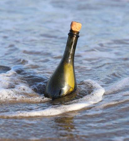 castaway: Secret Message in the glass bottle on the beach of ocean