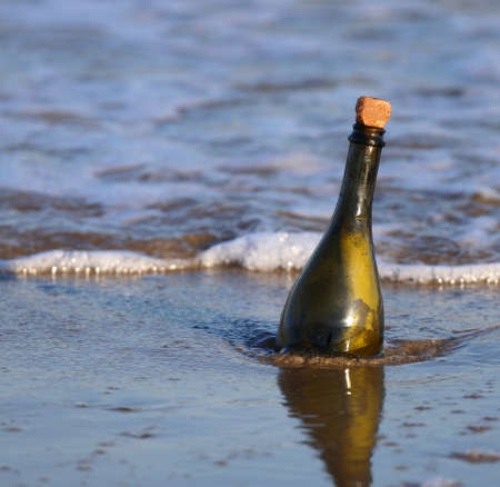 foreshore: Message in the glass bottle on the beach Stock Photo