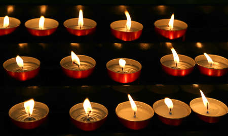 liturgical: candles lit with flickering flame in the church