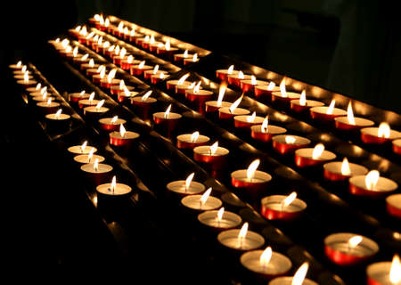 candles lit with flickering flame in the place of prayer