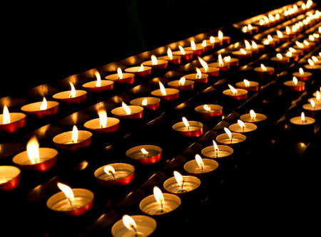 liturgical: many candles lit inside the place of worship
