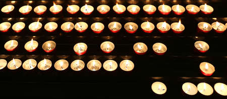 religiosity: candles lit with flickering flame in the church