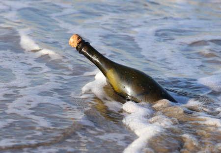 castaway: Secret Message in the glass bottle in the sea Stock Photo