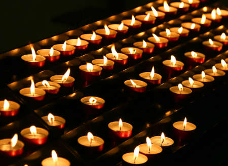 liturgical: many candles lit inside the place of worship to pray