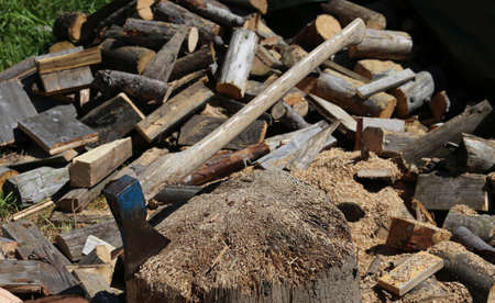 woodshed: big ax on the block of wood in the woodshed