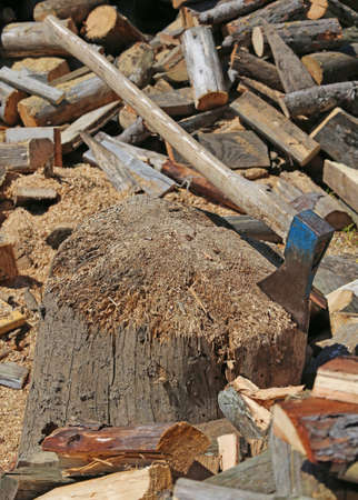 woodshed: ax of the woodcutter on the block of wood in the woodshed Stock Photo