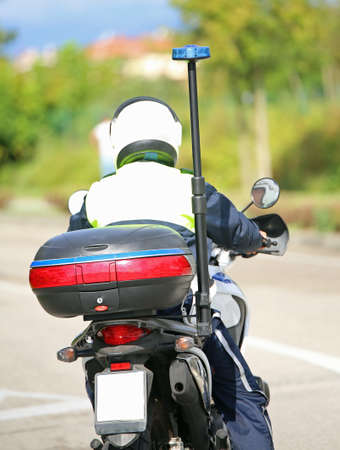 motorcycle officer: police motorbike with blue siren on the road