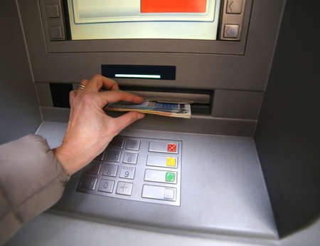 bankomat: hand of young woman while getting money from atm