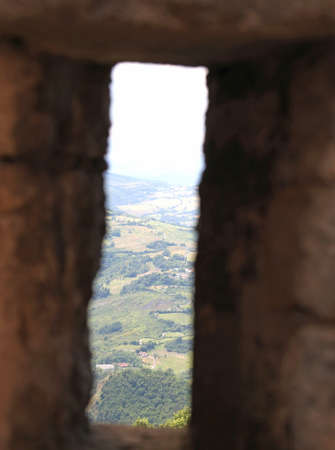loophole: view of the valley from the loophole in the walls of the medieval castle