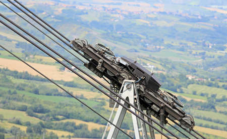 big steel cables and pulleys with gears of the mountain cable car