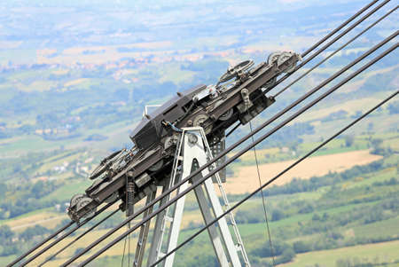 thick steel cables and pulley of the cableway in the mountains Stock Photo