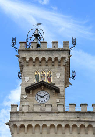 crenelation: detail of the clock tower of the main building in freedom square of in San Marino Country in Europe Stock Photo