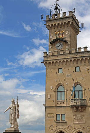 ancient statue of liberty and the great Palace of the Government of San Marino in Central Italy