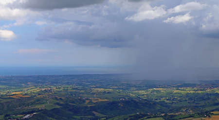 beautiful panorama of the plains of Emilia and the Adriatic sea in the background while raining Stock fotó